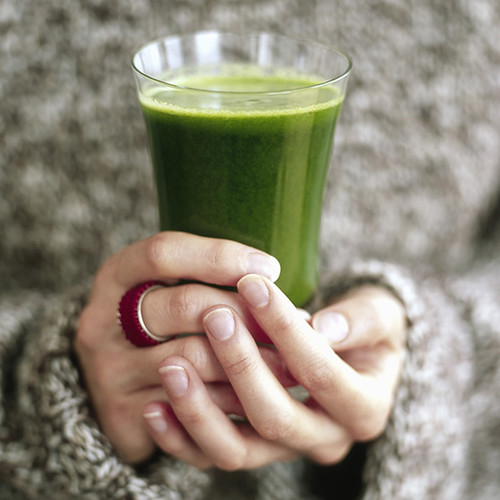 Health juice in hands | by Loua