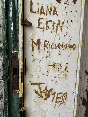 Names carved onto a door of an abandoned building in Torr Head on the Coastal Causeway of Ireland, UK