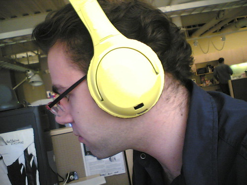 "the yellow headphones tell you, ""I'm working, and i want you to KNOW i'm working."" 