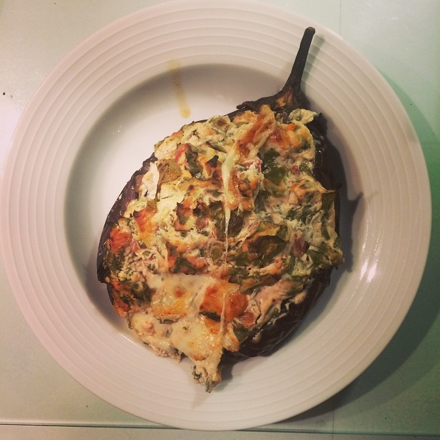 Completely under estimated how long this beauty would take to cook- whole aubergine stuffed with spinach, tomato, garlic, cream cheese and feta.