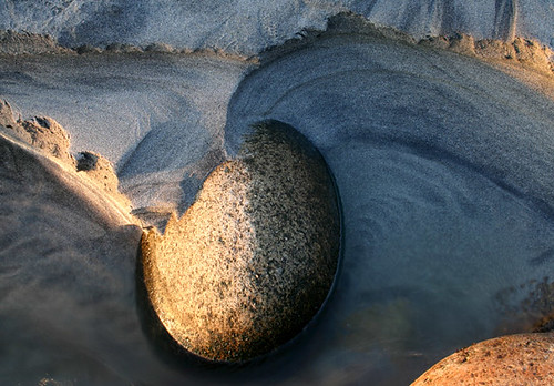 boulder in stream | by Adam Clutterbuck