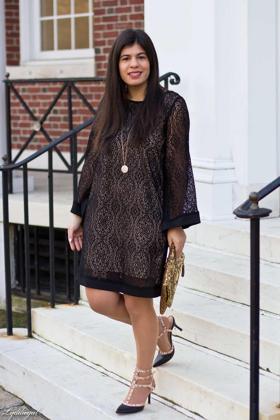 black lace dress, gold sequin clutch, studded pumps.jpg