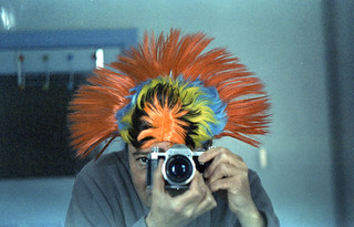 reflected self-portrait with Contax D camera and coloured headdress