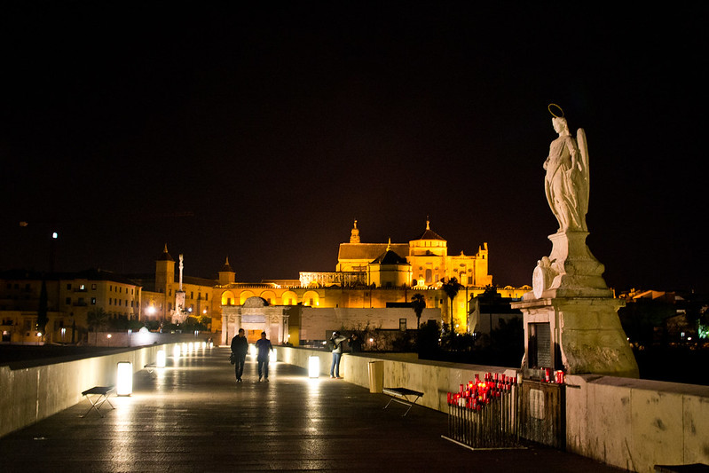 Crossing the Roman Bridge, Cordoba, Spain | packmeto.com