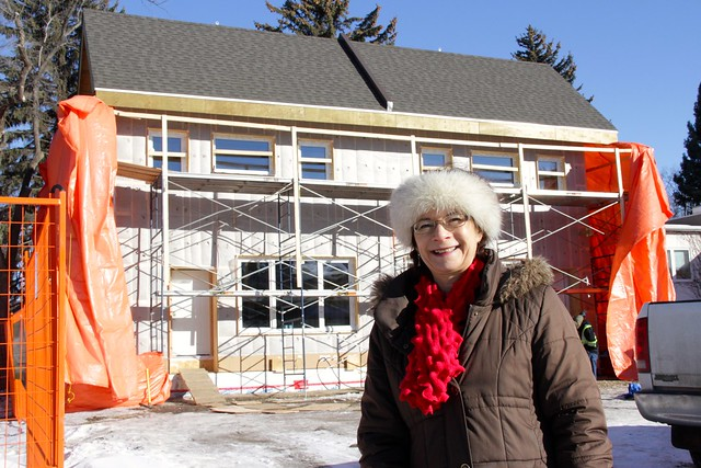 Holly Ann Knott in front of her  passive house