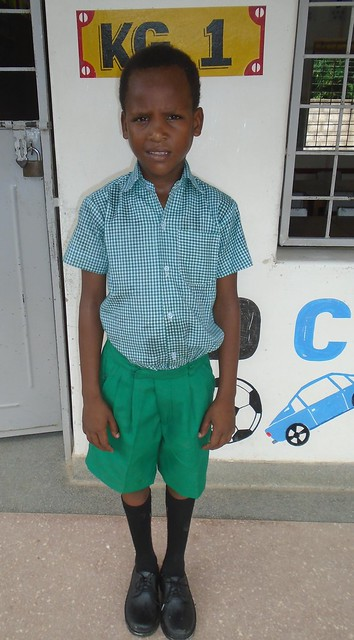 Victor in new school uniform having joined KG1, he has not attended school before