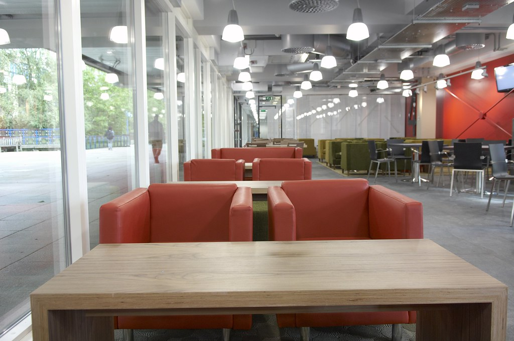 Soft seating and coffee tables by a window in 4W Cafe