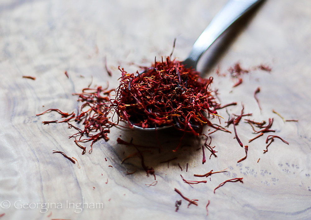 Georgina Ingham | Culinary Travels Photograph - A spoonful of beautiful, burnished red and yellow, Saffron Strands