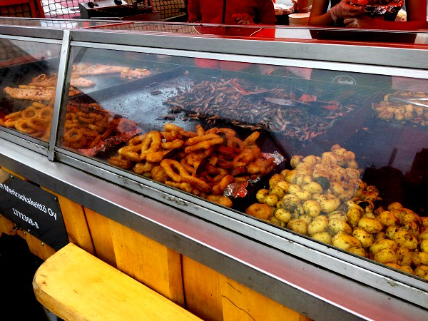 Amazing street food at the Helsinki Market. Whole potatoes with calamari rings and some small fish in the back ground. A great way to fill your tummy on your Helsinki stopover