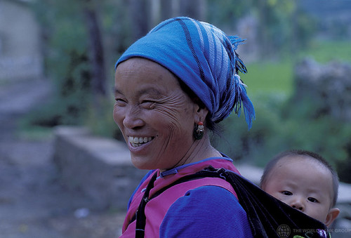Woman carrying child. China | by World Bank Photo Collection