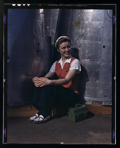 A noontime rest for a full-fledged assembly worker at the Long Beach, Calif., plant of Douglas Aircraft Company. Nacelle parts for a heavy bomber form the background  (LOC) | by The Library of Congress