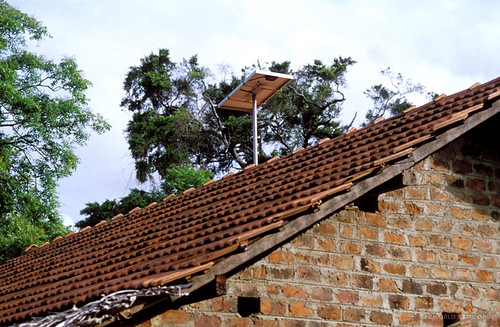 Solar panel on roof of village house used for lighting | by World Bank Photo Collection