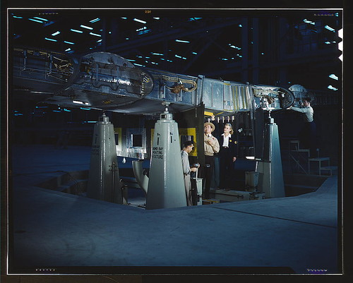 Working on wing of Consolidated Liberator Bomber, Consolidated Aircraft Corp. plant, Fort Worth, Texas  (LOC) | by The Library of Congress