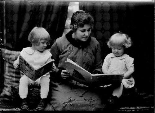 Student reading to two little girls. Photographed for 1920 home economics catalog by Troy. | by Cornell University Library