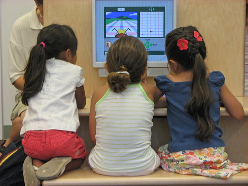 Three girls using the computer at the grand opening. | by San José Library
