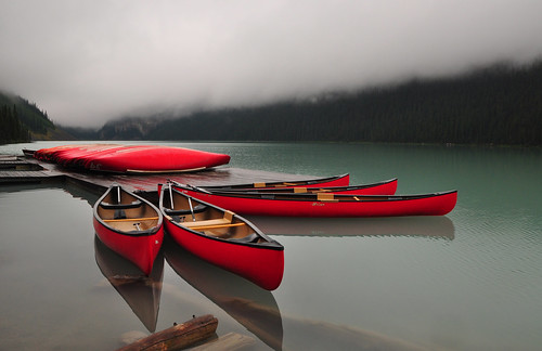 The Fleet of Red Canoes | by Bill Gracey