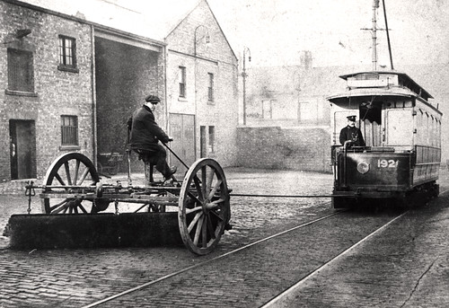 037281:Road-sweeper pulled by a tram Byker Unknown 1910