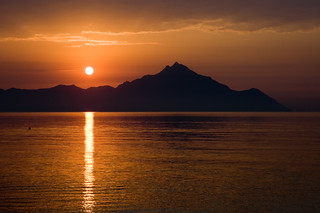 Bright sun in the morning over Mount Athos | by Horia Varlan