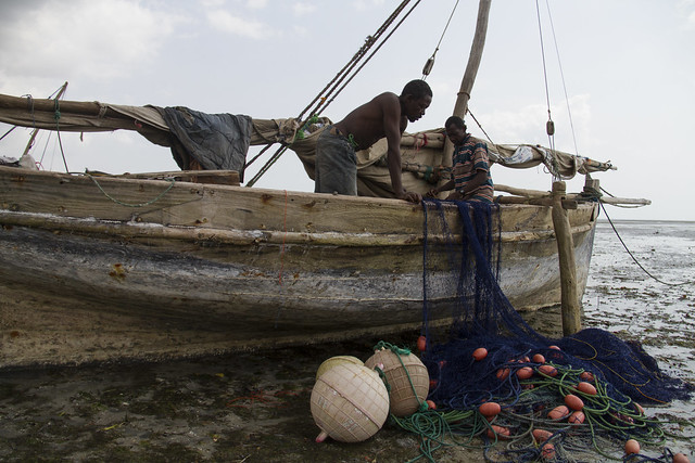 Fishermen at low tide prepare their gear for the next high tide in Bagamoyo, Tanzania. Photo by Samuel Stacey, 2013.