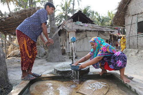 A man helping his wife to clean fish in Jessore, Bangladesh. Photo by M. Yousuf Tushar.