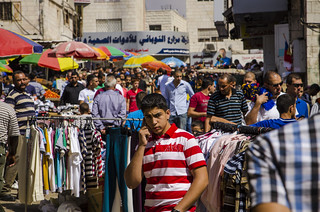 People in market near Ramallah's main mosque. | by World Bank Photo Collection