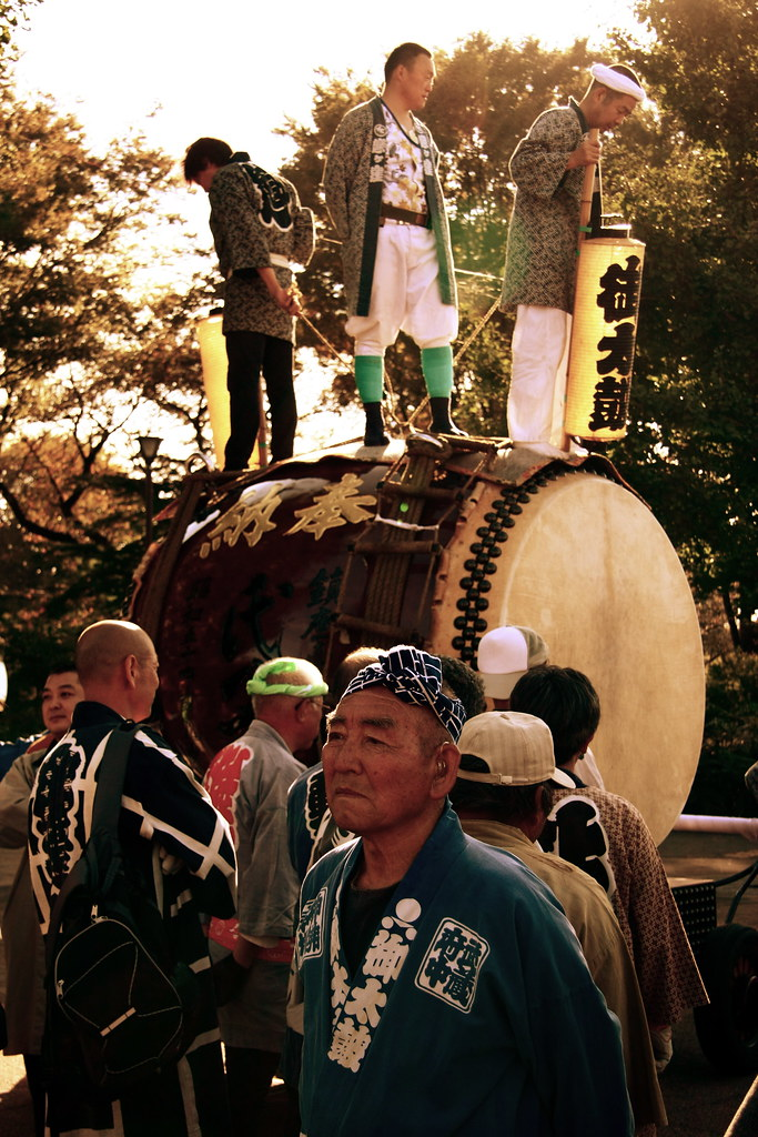 Men Parade With A Giant Taiko Drum
