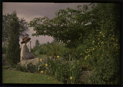 Ethel Dietz Nichols sitting on rock in garden | by George Eastman House