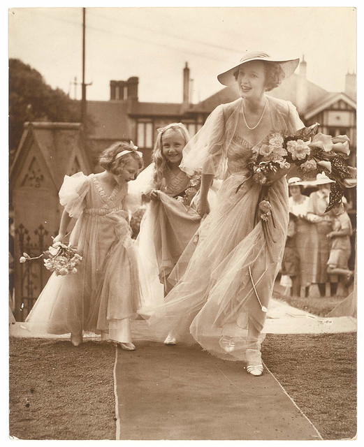 Bridesmaid and two flowergirls enter the church, St. Marks, Darling Point, c. 1930s by Sam Hood