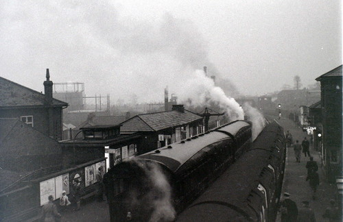 Steam train and Central Line Underground train, Epping Station, Greater London, November 1957