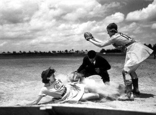 All American Girls Professional Baseball League player Marg Callaghan sliding into home plate as umpire Norris Ward watches: Opa-locka, Florida | by State Library and Archives of Florida