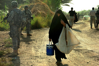 Iraqi woman and Soldiers | by The U.S. Army