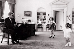 President Kennedy claps as his four-year-old daughter Caroline and son John F. Kennedy Jr | by thesmuggler- Night of the Swallow""