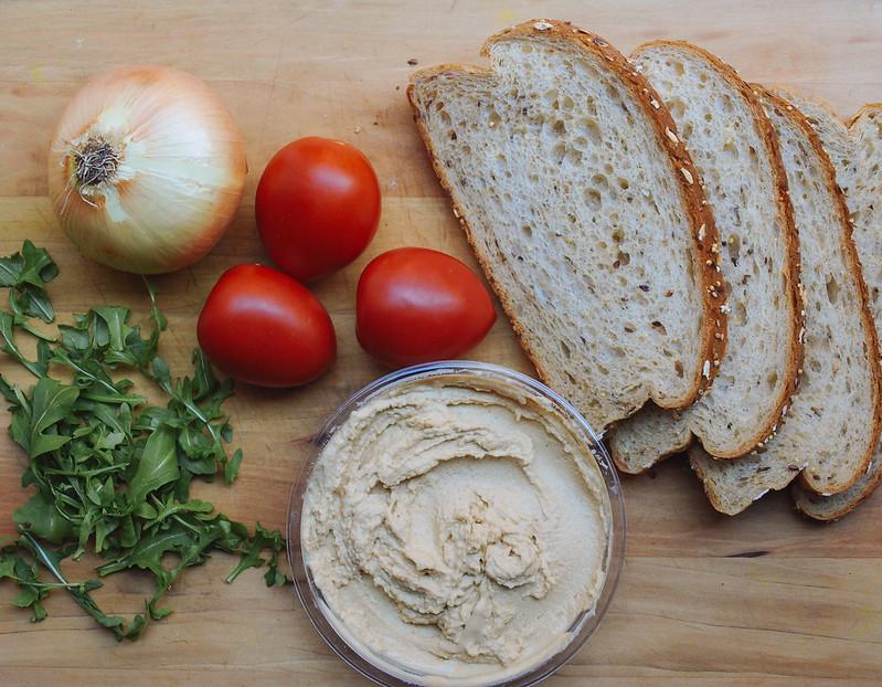Grilled Hummus Sandwich + Sautéed Onion,Tomato & Arugula