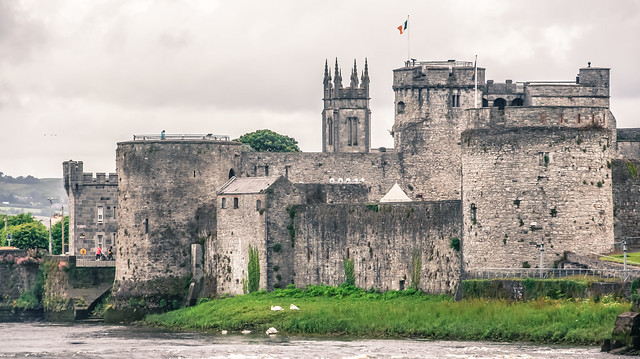 KING JOHN'S CASTLE IN THE DISTANCE AS SEEN FROM HONAN'S QUAY