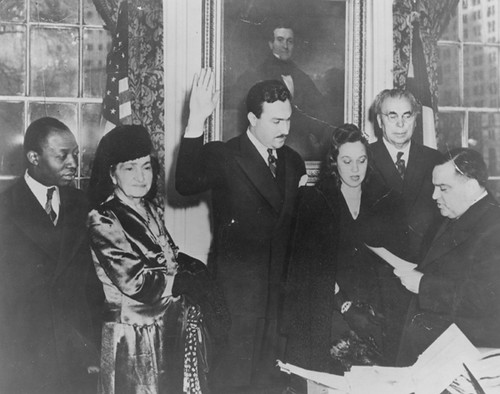 Adam Clayton Powell Jr. is sworn in to the New York City Council by Mayor Fiorello H. La Guardia. From left, Joe Ford; Powell's mother, Mattie; Powell; Powell's wife, Isabel; Powell's father, Adam Clayton Powell Sr., and La Guardia, January 1942. | by La Guardia and Wagner Archives