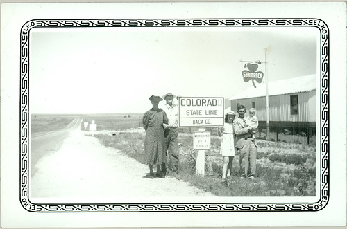 Group with Colorado sign