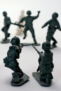 Two toy soldiers shooting into the distance | by Horia Varlan