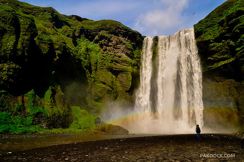 Girl staring at Skogafoss | by @PAkDocK / www.pakdock.com