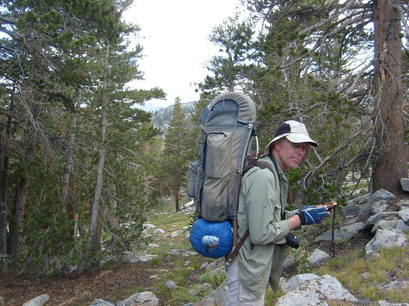 Me, carrying my GPS, as we bushwhack toward the waypoint I'd made at home for tonight's camping spot