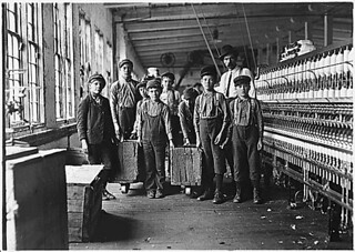 Some of the doffers and the Supt. Ten small boys and girls about this size out of a force of 40 employees. Catawba Cotton Mill. Newton, N.C., 12/21/1908 | by The U.S. National Archives