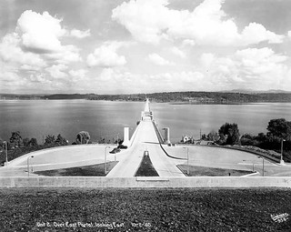 Looking east on the completed Lake Washington Floating Bridge, the only concrete pontoon bridge in the world, Mercer Island, Washington | by UW Digital Collections