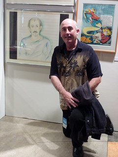 John Keister with his portrait by Lynda Barry, Counterculture Comix exhibit, Bumbershoot 2010 | by fantagraphics