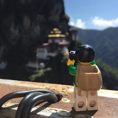 We both couldn't stop capturing this moment at the monastery. How many people does it take to make sure #Legopau isn't' blown away by the wind? Three! #Bhutan #travel #lego #love