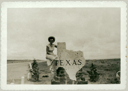 Sitting on the Texas Sign