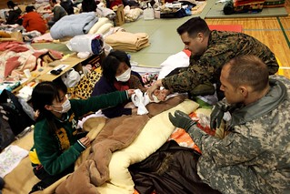 Medical care for tsunami victim | by Official U.S. Navy Imagery