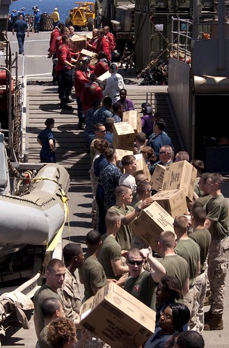 Sailors and Marines move supplies aboard USS Whidbey Island | by Official U.S. Navy Imagery