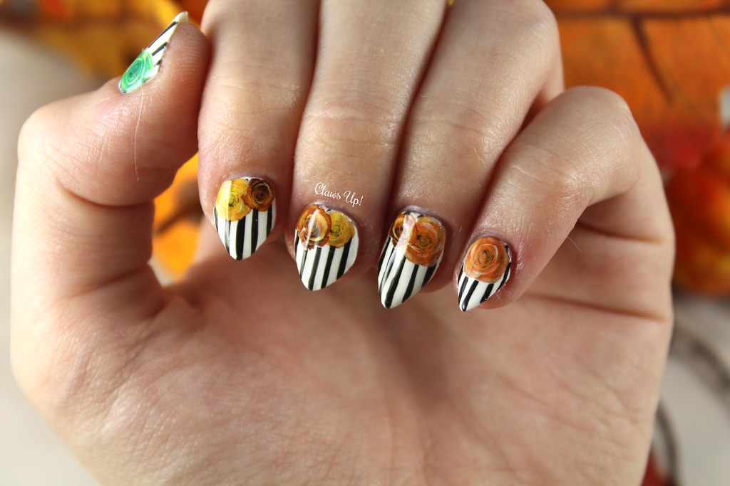 Stripes and roses Halloween nail art.
