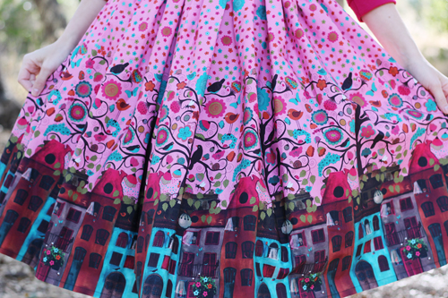 Miss Fortune Boardwalk Skirt in Amsterdam Flora & Fauna print Kitty Batwing Top in Cerise