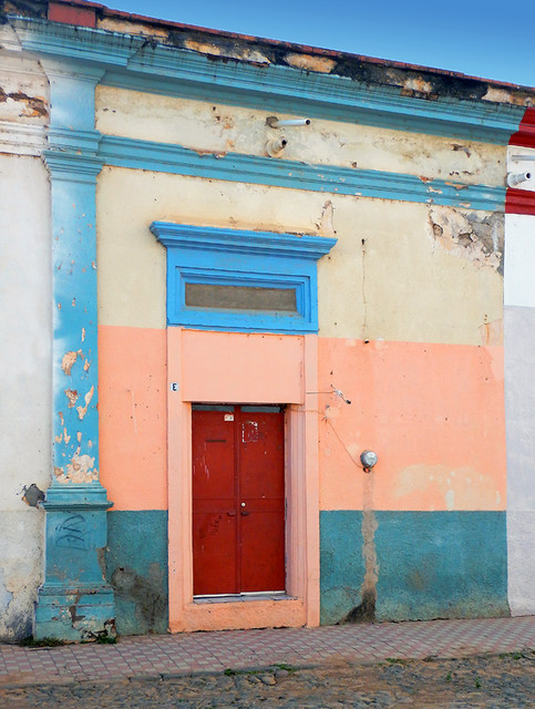 Bright wall with a red door in Talpa, one of Mexico's Pueblos Magicos in the Pacific high sierras