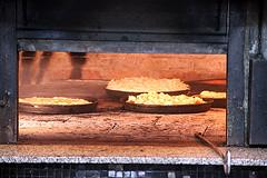 Dans le four à pizzas